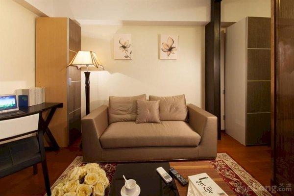 Pazhou Linjiang Shangpin Hotel Apartment - фото 10