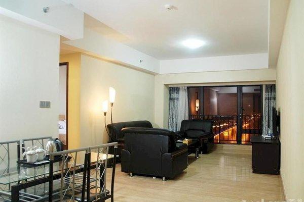 Pazhou Linjiang Shangpin Hotel Apartment - фото 8