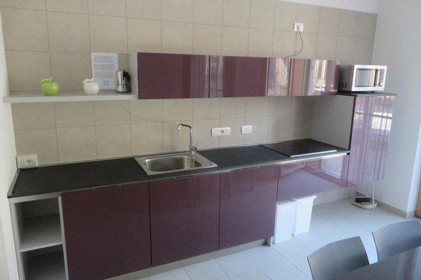 Komodo Apartments - фото 15