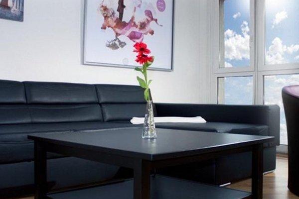 Arizo Apartments & Suites - фото 20