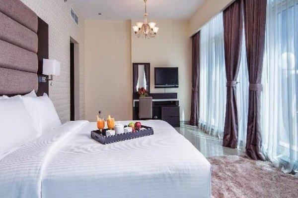 Emirates Grand Hotel Apartments - фото 2