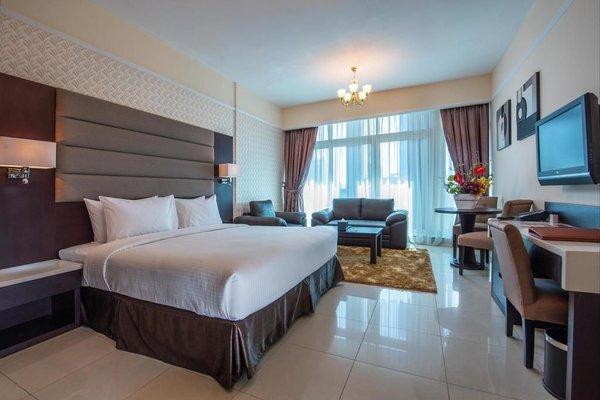 Emirates Grand Hotel Apartments - фото 4