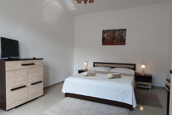 Madonna Apartments - фото 11
