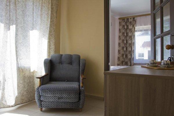 Orekhoviy Dvorik Guest House - фото 8