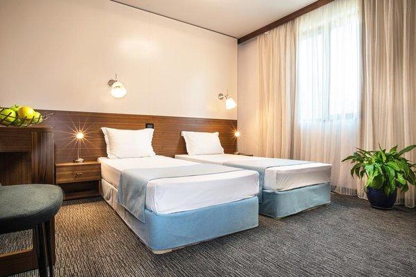 Uniqato Hotel - фото 50