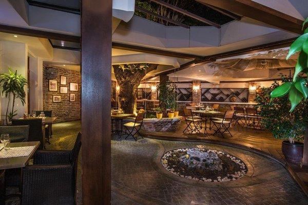 Uniqato Hotel - фото 14