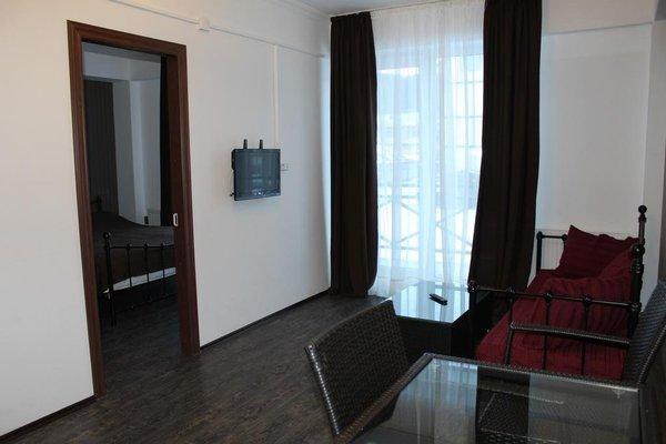 Отель Mgzavrebi Bakuriani - фото 16