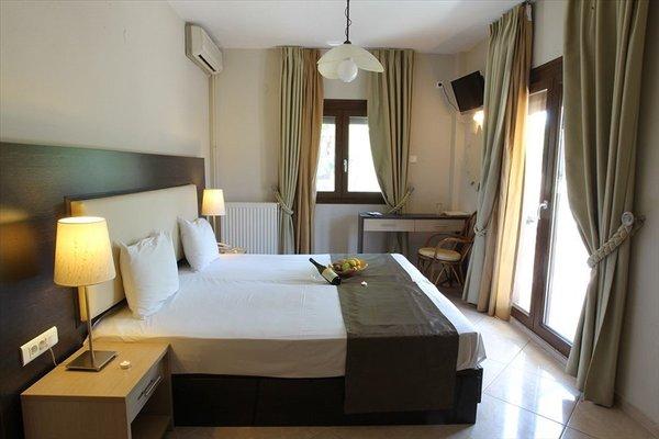 Meliton Inn Hotel & Suites - фото 2