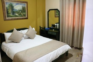 Holiday Suites Hotel & Beach Resort