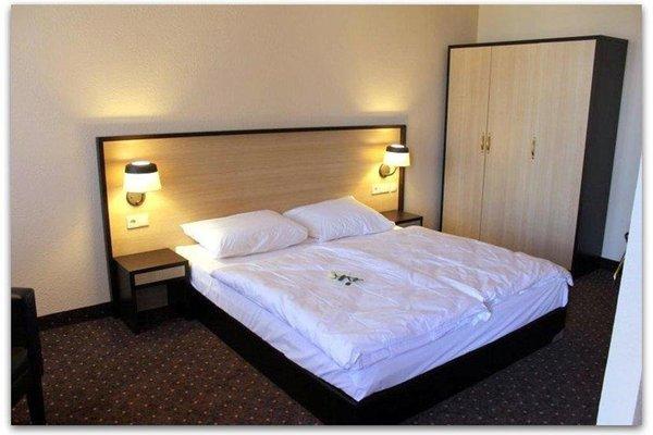 Ломсия отель - фото 1