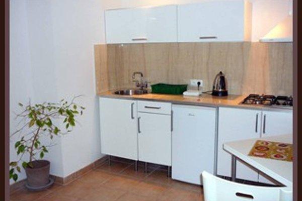 TopOne Apartments - фото 16