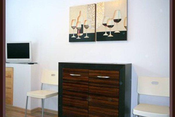 TopOne Apartments - фото 5
