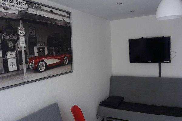 TopOne Apartments - фото 7