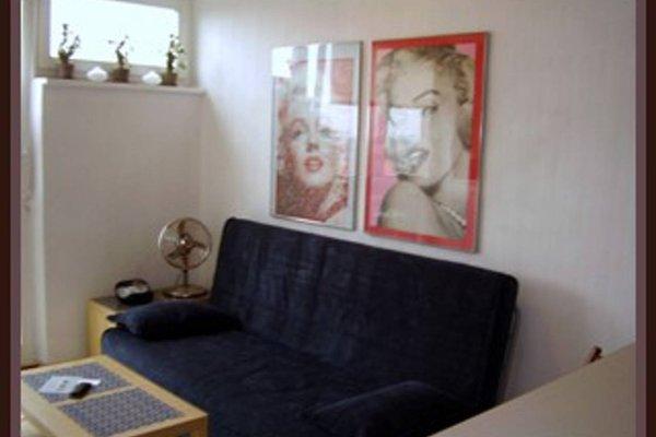 TopOne Apartments - фото 9