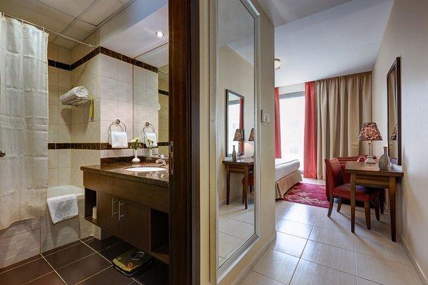 Abidos Hotel Apartment Dubai Land - фото 8