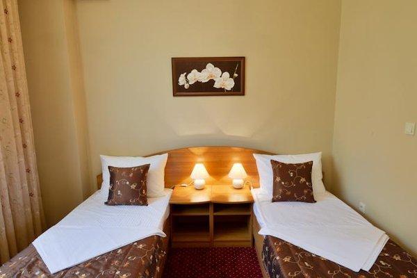 Отель Романов - фото 4