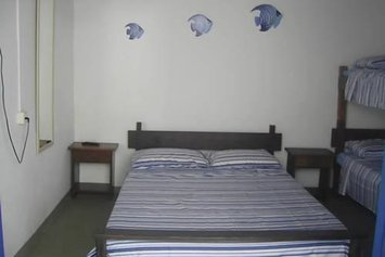 Suites Sueli Itaguá